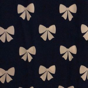 H&M Tops - Navy shirt with white bow pattern